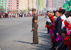 Keeping the crowds in line, Pyongynag (TeunJanssen) Tags: pyongyang parade military northkorea korea dprk youngpioneertours ypt olympus omd omdem10 travel 75mm 75mmf18 traveling worldtravel army comm