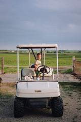 birthday boy, part one (manyfires) Tags: henry toddler boy child son kid nikonf100 film portrait peoplescape iowa rural midwest golfcart hogfarm pigfarm