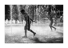Keeping Cool (Dave Fieldhouse Photography) Tags: london photo24 photo24london city summer sillouettes kingscross blackandwhite sillouette water fountains children fun splash urban playground capital streetphotography street fujifilm fujixpro2 fujinon35mmf2 fujinon wwwdavefieldhousephotographycom