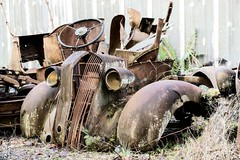 Tired Eyes (garshna) Tags: rusty junk abandoned vehicle truck automobile parts nikon headlights grill fenders
