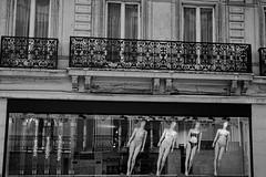 fallen woman in Paris (Mycroyance) Tags: paris france streetphoto street blackandwhite advertisment shoop woman
