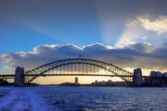 Harbour Bridge @ Sunset (Marian Pollock) Tags: australia sydney bridge harbour sydneyharbour sunset clouds nsw ocean water sunshine ship skyline buildings sun rays waves dusk light