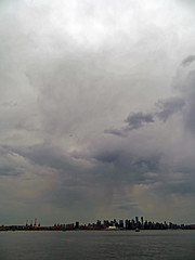 Summer storm over the city (Reva G) Tags: sky clouds storm rain grey gray vancouver bc northvancouver lonsdalequay water burrardinlet skyline weather virga