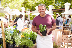 Man Selling Herbs And Plants At Farmers Food Market (FloridaFarmBureau) Tags: market farmersmarket herb plant garden customer buying fresh stall stand display business smallbusiness owner businessman selling retail healthy man men male colorful local happy smiling caucasian fifties 50s oneperson person people horizontal shopping healthylifestyle choice wellbeing apron consumerism serving unitedkingdomofgreatbritainandnorthernireland