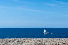 A White Sail (Mac ind Óg) Tags: blue islasbaleares summer capdartrutx spain majorca minorca balearicislands mallorca calanbosch walking menorca boat españa holiday white illesbalears seascape