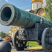 Close-up of Tsar cannon with tourists in the background