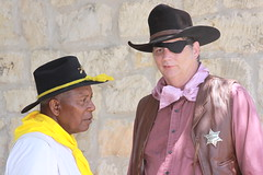 comrades in western apparel (miosoleegrant2) Tags: outside man male hat cowboy butch guy gentleman festival folklife texas tx texasfolklife sanantonio camp wilderness frontier west wildwest mature older men guys dude studly manly dudes handsome face profile stud neck working arms condid unware unexpected portrait facial hunk sexy masculine people persons grass