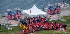 2018 - Vancouver - Canada Day (Ted's photos - Returns Late November) Tags: 2018 bc britishcolumbia canada cropped nikon nikond750 nikonfx tedmcgrath tedsphotos vancouver vancouverbc vancouvercity vignetting flag canadaday canadianflag tent monitor video videoscreen canadadaydrummingcelebration water falsecreek falsecreekeast eastfalsecreek people red redrule flags stage cans2s canadaday2018 2018canadaday canada151