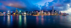 Panorama of Hong Kong City skyline at night. View from across Victoria Harbor Hongkong. (MongkolChuewong) Tags: aerial architecture asia asian background beautiful blue building buildings business china city cityscape day district downtown evening harbor harbour hong hongkong kong landmark landscape light metropolis modern mountain night office panorama panoramic peak peaks reflection scene scenic sea sky skyline skyscraper sunrise sunset tourism travel traveler urban victoria view