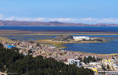 Lake Titicaca / Озеро Титикака (Vladimir Zhdanov) Tags: travel peru andes sky altiplano mountains puno lake titicaca urosislands water cloud landscape nature building architecture city tree bay