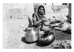 the wash up (handheld-films) Tags: india rural rajasthan portrait portraiture woman women people work labour household pots pans washingup street villages indian subcontinent mono blackandwhite closeup documentary