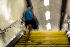 One Second London #1 (Sean Batten) Tags: london england unitedkingdom gb longexposure motionblur motion tube metro subway underground londonunderground europe nikon d800 58mm yellow blue person steps stairs lights tunnel