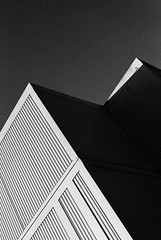 Ominous Cube (Thomas Listl) Tags: thomaslistl blackandwhite biancoenegro noiretblanc filmphotography minoltax700 kodak trix pushto1600 pushingfilm architecture geometry sky dark grain analog lines cube abstract