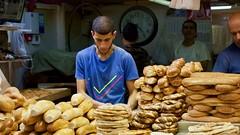 Bread Vendor (Toronto_hardhat) Tags: bread baker market makaneyehuda shuk jerusalem food nikon nikond7100 pita blue tshirt bagels