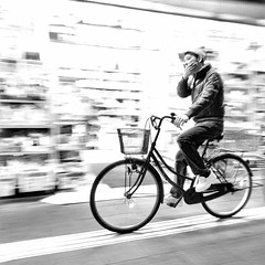 Ain't asleep at the wheel (cresting_wave) Tags: iphoneography mobileography iphonephotography mobilephotography streetphotography nightphotography blackwhite monochrome iphonex procamera snapseed man bicycle riding blur intentionalcameramovement icm motionblur