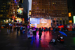 Times Square - NYC (DaveParryphotography) Tags: americanflag blue buildings cityscape lowlight manhattan midtown newyork newyorkcity nighttime northamerica rainy red thecity timessqaure travelphotography white city people thenight architecture building street umbrella sign winter