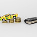 Toy car on coin stack with car keys