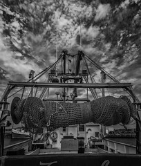 Business End - Havre-Aubert Fishing Boat (SNAPShots by Patrick J. Whitfield) Tags: lines patterns textures details reflections surface metal manmade mechanisms structure boat fishingboat lobster clouds rural urban skies mechanics blackwhite blackandwhite noire shadows light sunlight summer outside noiretblanc monochrome