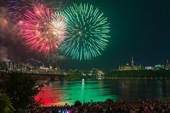 Canada Day Fireworks (Smaku) Tags: crowd parliamentbuildings bridge river nightphotography longexposure 2018 july1 canadaday fireworks canada ontario ottawa