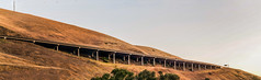 the long hangover (pbo31) Tags: livermore altamontpass eastbay alamedacounty country 580 roadway color nikon d810 july summer 2018 pbo31 boury sky bridge overpass panoramic large stitched panorama sunset brown