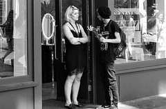 Looks like the answer is no.... (markwilkins64) Tags: story scene urban london carnabystreet streetscene streetphotography street streetphoto monochrome mono blackandwhite bw shop man woman blonde hat mirror reflections streetreflections summer dress hot camera conversation canon