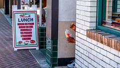 Santa Ana - Lunch (www.karltonhuberphotography.com) Tags: 2018 citystreets downtown hands hidden karltonhuber lunch man partialbody peoplewatching santaana shoe sidewalk sign southerncalifornia streetphotography streetscene windows