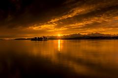 sunset 1321 (junjiaoyama) Tags: japan sunset sky light cloud weather landscape orange contrast color bright lake island water nature summer sunburst sunrays calm dusk serene reflection sunstar
