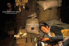 Chasing the dragon opium addict opium Northern Thailand South east Asia. (Homer Sykes) Tags: chasingthedragon opium pipe addiction addicted addict thai woman man drug abuse illegal smoking banned thailand goldentriangle hilltribes travelstock southeastasia peasant