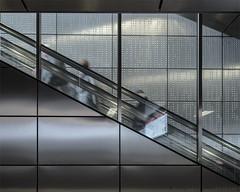 Braille (henny vogelaar) Tags: germany düsseldorf ubahn underground architecture modern metal glass reflections people motion color wehrhahnlinie lines ubahnhof benrather strase