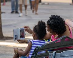 Facetime (poormommy) Tags: 2016 cuba cuba2016 lah lorrie vacation vacation2016 havana lahabana people street phone girl cellphone lady two beginnerdigitalphotographychallengewinner