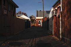 Walgreen Lane (OzGFK) Tags: 35mm australia melbourne pentax victoria walgreen analog cheapfilm colorfilm film streetphotography urban lane laneway alley cobblestone bluesky winter shadow