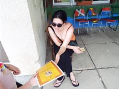 Jabukovac May 2018 - Olympics (sean and nina) Tags: jabukovac orthodox church olympics event sports day rural school country countryside serb croatian croatia balkan balkans eu europe european green grass bushes shrubs trees outdoor outside plants nature hot warm weather sun sunny wood primary building grounds hrvatska nina wife girlfriend fiancee beauty beautiful gorgeous stunning shoulders bare tan skin neck throat arms feet orange top black trousers candid public sunglasses brunette woman female girl lady married