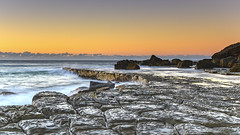 Tessellated Rock Platform and Seascape (Merrillie) Tags: australia beach blueskies centralcoast coast coastal dawn daybreak earlymorning forrestersbeach landscape morning nature newsouthwales nsw ocean outdoors rocks rocky sand sea seascape seaside sky sunrise surf tessellate tessellated tessellatedpavement tesssellation wamberal water waterscape waves weather