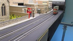 Multi-tasking tram driving 2 (kingsway john) Tags: london transport tram tramway layout 176 scale oo gauge model kingsway card buildings diorama 1950s