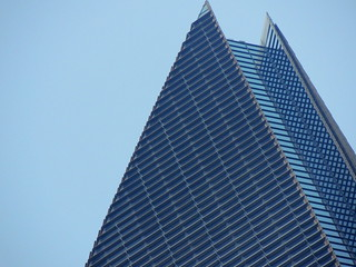 Top of blue pyramid glass modern building against blue sky - Shanghai, China