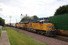 Eastbound freight with a SD60 three window (kschmidt626) Tags: union pacific train illinois rochelle park railroad graffiti bnsf burlington diamond