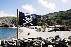 The Pirate Bay (jimiliop) Tags: pirate flag beach sea sand summer greece kythera kithira umbrellas greekislands