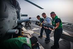 Sailors load an AGM-114 Hellfire missile onto an MH-60R Sea Hawk helicopter. (Official U.S. Navy Imagery) Tags: ussjasondunham ddg109 navy 5thfleet c5f sailors agm114 hsm48 hellfiremissile missile load vipers us5thfleetareaofoperations
