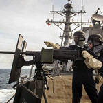 Sailors conduct a live-fire exercise aboard USS Mustin (DDG 89). thumbnail