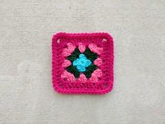 The previously one-round granny square transformed into a five-inch crochet square (crochetbug13) Tags: crochetcircles crochetbug crochet crocheted crocheting crochetremnants grannysquare