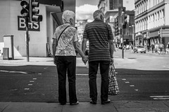 To Have and To Hold (Leanne Boulton) Tags: people road urban street candid portrait streetphotography candidstreetphotography candidportrait streetlife sociallandscape urbanlandscape old elderly aged man male woman female couple hands together friendship love loving tender beauty beautiful gentle storytelling pedestrian crossing care caring composition decisivemoment tone texture detail depthoffield bokeh naturallight outdoor light shade shadow city scene human life living humanity society culture lifestyle relationship canon canon5dmkiii ef2470mmf28liiusm black white blackwhite bw mono blackandwhite monochrome glasgow scotland uk