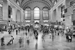 grand central (Andy Kennelly) Tags: ny nyc grand central station motion people subway windows flag bw