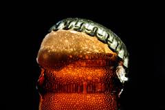 Pop The Cap On A Cold One (Mark Wasteney) Tags: macromondays refreshments beer bottle cap glass orange golden metal metallic lid bottletop foam bubbles liquid cold macro closeup fizz backlit