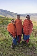 Maasai school boys (tmeallen) Tags: maasai schoolboys traditionalattire redrobes smiling village boma hills landscape ngorongoroconservationarea tanzania eastafrica unescoworldheritage rainyseason