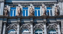 2018 - Romania - Bucharest - ANR - 1884 (Ted's photos - Returns 23 Jun) Tags: 2018 bucharest cropped nikon nikond750 nikonfx romania tedmcgrath tedsphotos vignetting building bulevardulreginaelisabeta windows columns sculpture