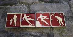 Warning: children, slipping, falling and seagull attacks (RedPlanetClaire) Tags: north wales britain beaumaris anglesey castle castell biwmares sign warning seagull