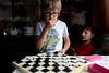 Grandfather's checkers (Alexis2k) Tags: checkers boy reverie задумчивость шашки thinking