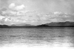 041269 12 (ndpa / s. lundeen, archivist) Tags: nick dewolf nickdewolf blackwhite photographbynickdewolf bw 1969 1960s 35mm film monochrome blackandwhite april usvi virginislands usvirginislands stthomas caribbean sky clouds coastal coast island islands landscape water ocean sea hills mountains