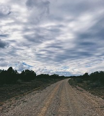 """My Ceiling Is The Clouds"" (bradhodges09) Tags: cloudceiling newmexicophotography newmexicoskies newmexico cloudsandsky cloudscapes clouds ruralexploration rural vanishingpoint gravelroads dirtroads poetryinpictures poetry"