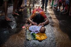 Faith (SaumalyaGhosh.com) Tags: faith ritual india kolkata travel people life color calcutta baby water dondi custom street streetphotography
